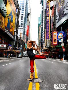 Yoga Meets High Fashion in Times Square-From the Enchanted Forest of Connecticut, to the throbbing energy of Times Square, Artist Robert Sturman continues his photographic essay of the East Coast Yoginis. In the photo below, Anusara Teacher and LuluLemon Ambassador Megan Kuczynski stops traffic on 42nd Street!
