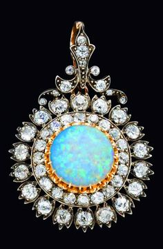 A Victorian opal and diamond cluster pendant by West & Son, Dublin, c.1870.
