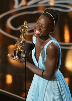 """Lupita Nyong'o accepts the award for best acress in a supporting role for """"12 Years a Slave"""" #Oscars"""