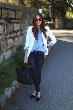 White blazer, denim shirt and dark blue jeans. Topped off with a Celine handbag.
