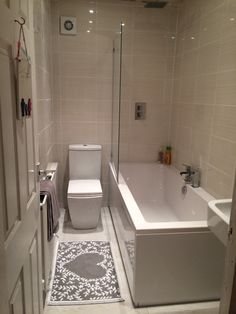 Kathryn from Merthyr tydfil #VPShareYourStyle we love the heart rug in this bathroom with a white bath and modern toilet.