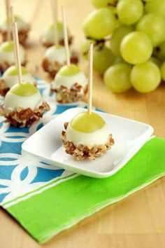 Grape pops with white chocolate (frosting) and nuts