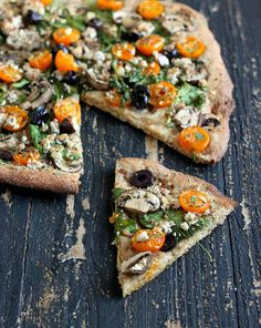 Vegan Mediterranean Pizza with Almond Feta, Mushroom, greens, olives, golden cherry tomatoes. Vegan Soy-free Recipe