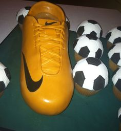 Nike Cleat Cake with soccer ball cupcakes - This is a groom's cake for a groom who loves soccer. Shoe cake was chocolate with Vanilla Bean Cream Cheese filling covered in buttercream and fondant. Soccer balls are lemon cupcakes topped with a Merkel's candy coating dome and then fondant panels. I got the dome candy molds from Wilton. The cupcakes were more labor intensive than the shoe! soccer parti, balls, cleat, candies, shoe cakes, soccer shoes, candy molds, groom cake, lemon cupcakes