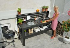 An outdoor kitchen can be an addition to your home and backyard that can completely change your style of living and entertaining. Earlier, barbecues temporarily set up, formed the extent of culinary attempts, but now cooking outdoors has become an. Simple Outdoor Kitchen, Outdoor Kitchen Design, Outdoor Spaces, Outdoor Living, Outdoor Decor, Bbq Shed, Outdoor Sinks, Small Backyard Landscaping, Summer Kitchen