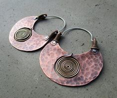 These earrings are the epitome of ancestral Creation - the Life Spiral inside the copper womb. The two metals fit together, one inside the other, like a new Life growing inside the Earth Mother. If you turn these earrings upside down, they look like Hips the Framework that supports the Womb of all Life. And the size - oh how I am drawn to the size! Womens hops are to be large and spacious - therein grows the body for the Divinely Gifted Soul. The size is luscious - so sensual. I love these…