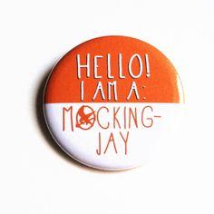 """""""Hello! I am a mockingjay"""" button. $2.75, via Etsy."""