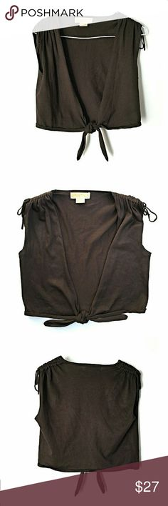 Michael Kors Mini Tye Vest In excellent condition. No major signs of wear. Great with any casual outfit!  Size small.  Smoke and pet free home. Ships within one day. MICHAEL Michael Kors Jackets & Coats Vests
