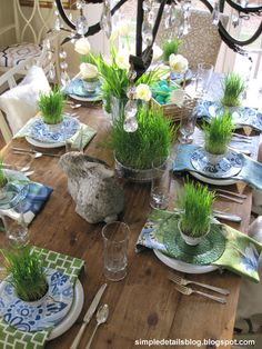 Spring table setting, wheat grass potted in tea cups for each place setting, mix of formal tea cups, modern pattern plates, geometrics