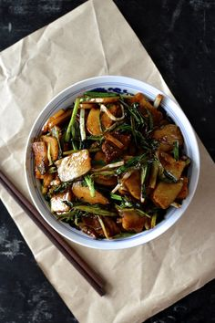 This Chinese rice cake stir-fry is the best. The delightful glutinous Nian Gao heaven that is the rice cakes, tender slices of steak, the savory seared scallion and ginger, and the rich umami flavor of the soy and shaoxing wine is not to be missed