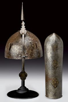 A khula-khud and a bazu-band                                                     category:                 ORIENTAL ARMS                    provenance:     Indopersia                    dating:       early 19th Century