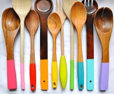 Easily brighten up your kitchen by dipping your wooden utensils in non-toxic craft paint. Pretty enough to hang, or makes it easy to find what you're looking for in a drawer.