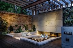 Outdoor Lounge With Sunken Seating Area And Fireplace | Home Design and Decorating Ideas and Interior Design