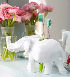 Tranform your old wooden figurine into a quirky toothbrush holder.