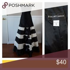 Black and White Satin Ball Gown Strapless black and white ball gown. A-Line with ruffled bottom. Black and white striped with black bows. Worn once for pageant. Perfect for prom, pageant, or other formal event. Jessica McClintock Dresses