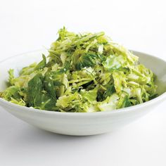 Warm Brussels Sprouts Salad This simple side of sauteed shredded brussels sprouts goes well with pork chops, sea scallops, or roasted chicken.