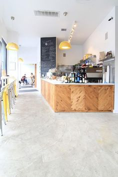 Lark Cafe in Brooklyn by Kimberly Peck Architect, Remodelista. Just glass cases underneath some of that wood. A little wood to trim it, and a display case. THIS is incredibly gorgeous! Cafe Interior Design, Retail Interior, Cafe Design, Wood Design, Modern Interior, Design Design, Cafe Bar, Cafe Shop, Hotel Restaurant