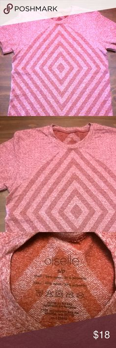 Oiselle Short Sleeve EUC. Worn once.  I love this top. It's seamless, stretchy, and has a cool design. I do not reach for reds/pinks.  The photo of the collar is the best representation of the color. Strawberry and cream. oiselle Tops