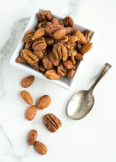 Quick Maple Candied Pecans and Almonds   nourishedtheblog.com   An easy and quick maple candied pecans and almonds recipe made gluten free and vegan with toasted nuts, maple syrup, vanilla and sea salt. This is the perfect sweet snack or salad topper!