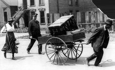 'Red Summer' 1919 Chicago Race Riots | Black residents of the Chicago south side move their belongings with a hand-pulled truck with police escort.