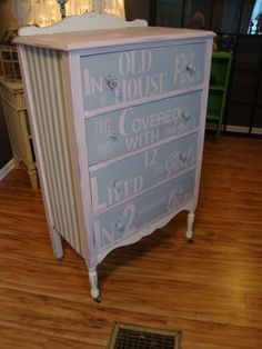 "This dresser was painted in pink, gray and off white with the opening sentence from the book ""Madeline"" stenciled on the drawer fronts."