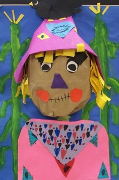 1st Grade 3D Scarecrows. First graders created a 3-dimensional scarecrow head for fall. They painted a cornfield for the background and added many details to decorate the scarecrows shirt and hat! We discussed the difference between 2-D and 3-D art.