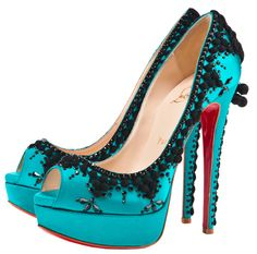 """Gah! Gorgeous Louboutins! Paired with the perfect """"little black dress"""", to die for. Too bad I'm 6 ft. tall and can't have the pleasure of wearing heels...sigh."""