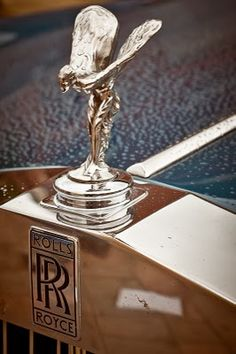 The emblem and badge of a Rolls Royce. Rolls Royce, Lifestyle Photography, Musical Instruments, Badge, Vehicle, Classic Cars, Spirit, Bling, Dreams