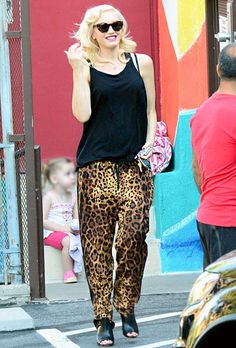 Gwen Stefani was all smiles as she hid her pregnant belly under a loose black tank and baggy, leopard-print pants.