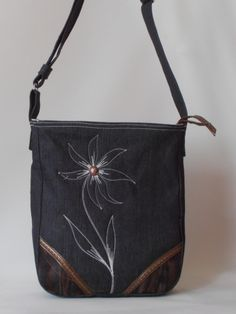 black messenger bag embroidered with flowers