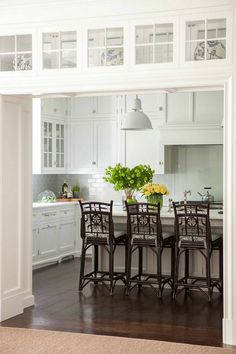 Kitchen Doorway. A kitchen doorway is fitted with glass display cabinets leading…