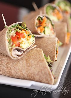 California Veggie Wraps  •4 large whole wheat tortillas  •4 tablespoons cream cheese  (or lowfat neufchâtel cheese)  •2 cups baby lettuce  •1 cup shredded carrots  •1 cup sprouts  (I used a mix of clover and radish sprouts)  •1 avocado, sliced  •1 medium red bell pepper, sliced  •1/2 cup colby jack cheese, shredded