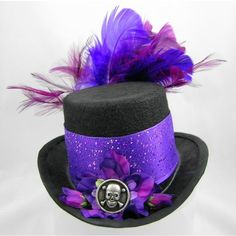 Mini Top Hat Pirate Skull Halloween Purple Sparkle and Feathers ($80) ❤ liked on Polyvore featuring costumes, queen costume, pirate halloween costumes, burlesque costumes, victorian costumes and gothic halloween costumes