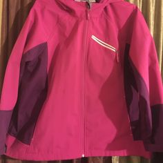 Sale Cute Spring Jacket Purple & Pink w/thin lining                      Velcro sleeve adjusts, hooded jacket, zipper pocket at top & 2 at waist each side             worn 2x like new conditionperfect for Spring & Rain great buy, no stains or any damage Free Tech Jackets & Coats