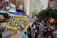 Falun Gong March in Hong Kong Inspires Chinese Tourists to Quit the Communist Party on Its National Day