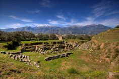 Ruins at Sparta with Taygetos Mountains in the background. These ruins were said to be homes.