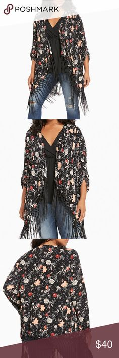 """Torrid Floral Print Fringe Kimono """"Fancy yourself a flower child? This kimono has real hippie-hippie shake potential. The black crepe open front style blooms with a multi-color floral print, yet never strays too far out with tab sleeves. The knotted fringe along the hem was designed with twirling in mind. Approx measures 39"""" from shoulder. Rayon."""" New with tags, size 2X. torrid Tops"""