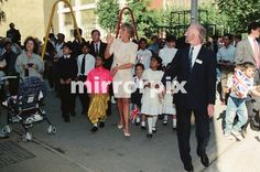 September 17 1991 Princess Diana, tours the Guinness Estate in Mansell Street, Aldgate, East London. During the visit she was greeted by many Bengali and Asian children, three of which walked her through her visit