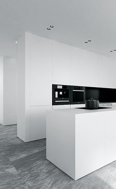 Minimal white kitchen by Tamizo Architects