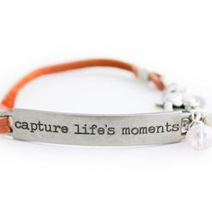 """This leather bracelet is engraved with an inspirational quote that makes it a great gift, especially if you are looking for a photographer gift. Quote jewelry is in high demand for this season, and this one is stamped with """"capture life's moments"""". A pair of these quote bracelets would be perfect modern friendship bracelets. Great for gift-giving, you will receive this beautiful inspirational quote bracelet in an aqua gift box with the bel monili logo atop.Hop on our VIP email list and get an in Bracelet Quotes, Jewelry Quotes, Easy Gifts, Great Gifts, Pewter Plates, Photographer Gifts, Deer Skin, Tan Leather, Crystal Beads"""