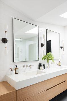 Swan Lake House: The Casual Bonus Rooms pretty vanity design. One bigger mirror framed with sconces Bathroom Sconces, Wood Bathroom, Bathroom Cabinets, Bathroom Furniture, Modern Bathroom, Small Bathroom, Bathroom Lighting, Master Bathroom, Modern Vanity