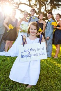 Sign held by the flower girl. Was double sided.
