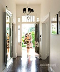 Beautfiul entry hall, love the big mirror on the wall.