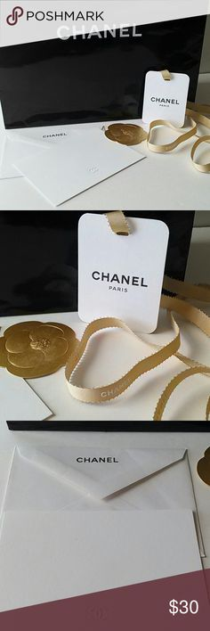 """CHANEL Gift Giving Bundle You will receive: *Chanel Card and Envelope *Chanel Gold Camellia Paper Flower, Sticker on back *Chanel Gold Ribbon with White Lettering *Chanel Hang Tag *Chanel Medium Paper Tote Bag, 10 1/2"""" long, 9"""" wide and 4 1/2"""" at the bottom. CHANEL Other"""