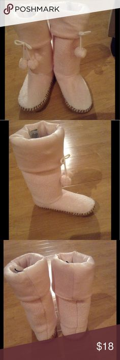 Concierge Collection Slipper Boots NWOT!!  These ivory slippers have a tan grip bottom, 2 hanging Pom poms on the front of each, can be worn higher or rolled down, & are 100% Polyester.  Machine washable!!  & super soft & cozy!! Concierge Collection Shoes Slippers