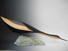 """Fishing Shorebird.  Carved Pine, Stone base.  36"""" long.  by TJ McDermott www.tjmcdermott.com"""