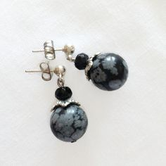 These earrings consist of snowflake obsidian beads, small onyx beads and silver beadcaps. They match the Mottled Black Gray Bracelet or the Black and Silver Necklace Etsy Earrings, Pearl Earrings, Black And Grey, Gray, Snowflake Obsidian, Snowflakes, Turquoise, Beads, Bracelets