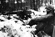 An American M1917 Browning machine gunner takes time out for a pipe smoke during a lull in the Ardennes. #WW2