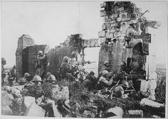 French troopers under General Gouraud, with their machine guns amongst the ruins of a cathedral near the Marne, driving back the Germans. Central News Photo Service., 1918