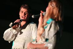 ARCADIA, CA - DECEMBER 14: Actor Garrett Clayton (L) and actress Emma Degerstedt perform onstage as Westfield Santa Anita celebrates the holidays with a free Winter Wonderland Party at Westfield Santa Anita on December 14, 2014 in Arcadia, California. (Photo by Imeh Akpanudosen/Getty Images for Westfield) — at Westfield Santa Anita.